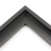 This stair step wood floater frame has a matte black finish with a steep upper and small lower step. The canvas will hover neatly within the simple, modern border. 